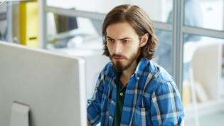 IT specialist focusing on computer problem